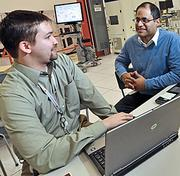Ryan Gallagher, left, a factory automation engineer II, with Pedro Gonzalez, the global university relations manager. Gallagher, out of RPI, was the first college recruit at the Malta site.
