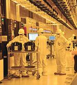 GlobalFoundries starts first contract as payroll surpasses 1,100