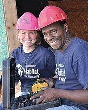 AmeriCorps volunteer Kelly Ferguson with Habitat site supervisor Alphonso Gavin.