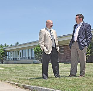 Lou McIntosh, left, Brunswick (Brittonkill) Central Schools superintendent, with Richard Curri of NAI Platform, at the Parker School in Pittstown.