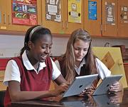 Investing in technology: Eighth graders Sabine Stain, left, and Allayla Silipigno use iPads at The Albany Academy for Girls.