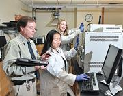 Russell Sage associate professor Thomas Keane, left, at work in The Interdisciplinary Studies in Emerging Sciences, or ISES, lab with students Hsin Hwei Li and Monique Merchant.