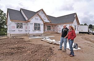 Todd Stewart, president of Stewart Construction Inc., says his company is building more houses this year. He is pictured here with his sister, vice president Heather Stewart, at a house they are building in Ballston in Saratoga County.
