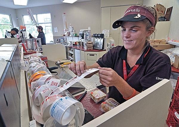 At a Stewart's Shops Loudonville store, employee Toni Wowk labels sandwiches. At the 328-store chain, operating profits after taxes increased 30 percent in the last five years.
