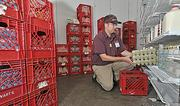 Store manager Alan Ryan stocks shelves at the Stewart's Shops Loudonville store. Revenue from the company's 330 convenience stores has been growing.