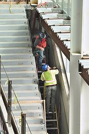 Work proceeds in the new University at Albany School of Business.