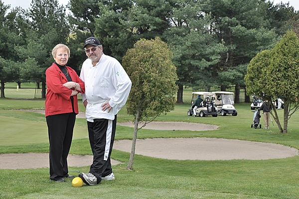 Shawn Roff, right, leased the restaurant at the Van Schaick Island Country Club at the start of the year. Here, he appears at the course with manager Judy Pfeiffenberger.