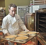 Cinnamon & Spice Bakery owner John Zumbo said Apple technology is one of the tools he is using to convince a bank to loan him money.