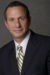 Dennis A. First