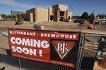 Uptown bucks economic downturn to lure high-profile retailers