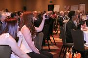 Tech-savvy attendees took photos, videos and tweeted during the presentations.