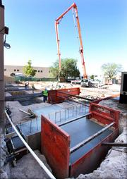 From the Aug. 3 print story:Smart Strategies: Kirk McWethy, president, SDV Construction SDV does a large concrete pour at the Construction Veterans Hospital construction site. You don't get to see such a large concrete-pouring crane every day.