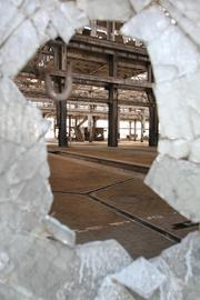 From the Aug. 17 print story:Berry's Rail Yards effort aims to rev up Albuquerque The framed view through a pane of shattered glass is indicative of the building's current condition.