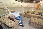 """From the Aug. 17 print story:Legislative film incentive showdown, the sequel? I-25 Studios CEO Rick Clemente relaxes on a stage set at the studio. """"Here it is!"""""""