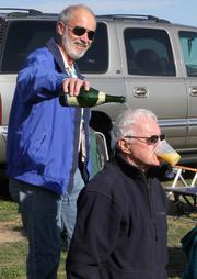 "From the October 8 online story and photo gallery: Balloon Fiesta lifts off [PHOTOS] Arizona balloon pilot Mike Fleury pours champaign on the head of 81-year-old Larry Richards during a ""first-timer ceremony,"" after Richards' first time up in a balloon."
