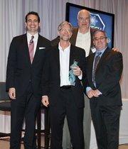 Gary Oppedahl (center) and John Joseph (center right) accept TriLumina's award as innovation category winner, alongside Ian Anderson and Brian Rashap.