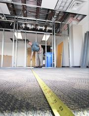 From the Aug. 31 print story:For some growing companies, now's the time to buy property Ultramain President Mark McCausland measures a room at the company's new building.
