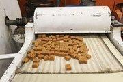 Caramel squares being cut