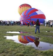 After recording the driest year on record, rains fell at the Albuquerque International Balloon Fiesta, affecting attendance.