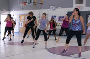 U.S. New Mexico Federal Credit Union employees and community members participate in the firm's first Zumbathon in June 2013. The Zumbathon was held at Alamosa Elementary school and raised $300, which will be donated to the school for classroom supplies.