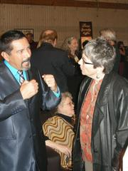 Film industry supporter and actor Steven Michael Quezada, left, chats with Jo Edna Boldin, a casting agent.