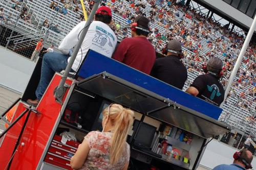 "Members of the Sacred Power team in the ""Pit Box."""
