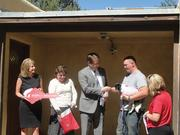 Wells Fargo donated a mortgage-free 1,179-square-foot home to Retired U.S. Army Sgt. Christopher Smith in Albuquerque in collaboration with Operation Homefront. Sgt. Smith served as an Army gunner on an LMTV (Light Medium Tactical Vehicle). He was injured by an improvised explosive device during a mission in Iraq and returned to New Mexico to recover. The home donation was part of a national program through which Wells Fargo and Operation Homefront provide sustainable housing to veterans who are not currently homeowners. Operation Homefront is a national nonprofit that provides emergency assistance to military families and Wounded Warriors.Pictured, Sgt. Christopher Smith is presented the keys to his new home by representatives of Wells Fargo and Operation Homefront.