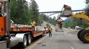 With state officials concerned that monsoon rains would lead to flooding after wildfires, NMDOT officials delivered barrier walls to Los Alamos County.