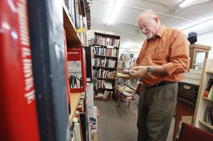 After 25 years, Simmons & Simmons Fine Books will close its retail store. Pictured is the store's Dana Bowley. He and his wife Melanie Simmons Bowley will continue the operation online from their Los Lunas home.
