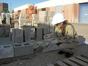 Topaz Torres from Hobbs High School, puts her masonry skills to use in the SkillsUSA Competition at CNM.