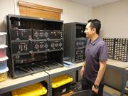 Steve Sauceda examines NMJC's fuel cell and battery backup training equipment.