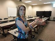 """Facility Scheduling Coordinator LaRae Berry shows one of NMJC's """"smart rooms,"""" where standard and customized training takes place."""