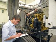 Justin Najar from Carlsbad High School works to identify components in a diesel engine at the SkillsUSA competition at CNM.