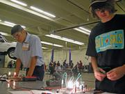 Jaime Montes, left, and Jesse Madigan work on diagnosing automotive electrical problems in a simulation at the USASkills competition.