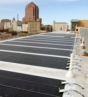 The roof is lined with photovoltaics to generate electrical power.