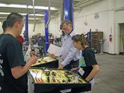 Jim Maddox, owner of Jim's Automotive, supervises students at the SkillsUSA competition at CNM.