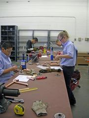 Students work on plumbing components as part of the SkillsUSA competition at CNM.