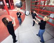 Members of large company winner, Sandia National Laboratories, play ball.