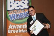 Juan Romero of SolutionWerx Inc. celebrated the company's fifth-place win in the small company category.
