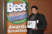 Mark Gonzales, CEO of Mark Pardo Salonspa, enjoys the company's eighth-place win in the medium company category.