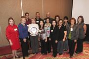 Marpac Inc. employees enjoyed their company's first-place win in the medium company category.