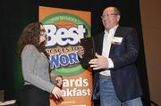 Business Weekly Associate Editor Rachel Sams presents the fourth-place award for the small company category to Kevin O'Hea of Academy Reprographics,