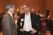 Gary Oppedahl of FootPrints Home Care chats after the company's third-place win in the medium company category.