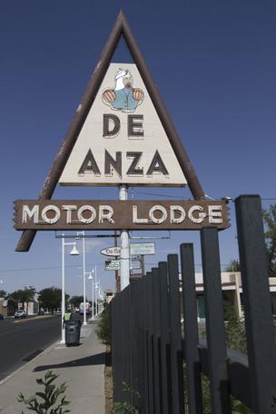 Developer Rob Dickson's plan for a restoration of the De Anza Motor Lodge has been sitting in Washington, D.C. for three months awaiting approval, delaying the project for at least six months.