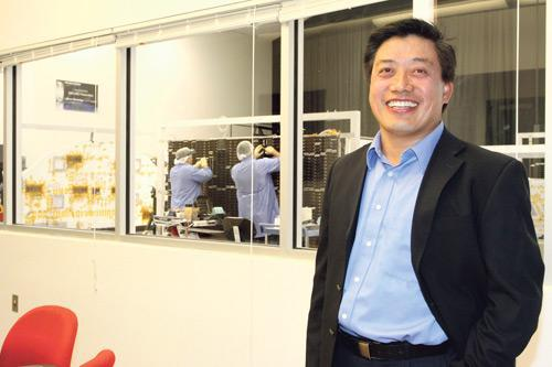 Pictured is Emcore President and CEO Hong Hou.