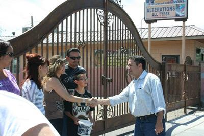 Griego (right) shakes hands with attendees of the South Valley Pride Parade earlier this year.