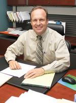 UNM HSC's Larson, colleagues tackle new roles