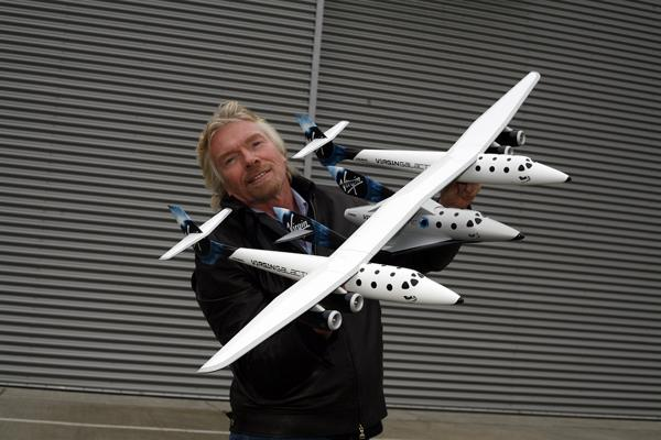 Sir Richard Branson has rocketed to the top of LinkedIn's new Influencer's list with more than 1 million followers. Pictured is Branson with a model of Virgin Galactic's Mother Ship.