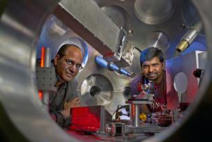Rahul Shah (left) and Sasi Palaniyappan (right) are pictured inside a chamber where the TRIDENT laser is aimed at a thin foil target.