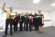 YMCA and Albuquerque Hispano Chamber of Commerce representatives prepare to cut the ribbon to dedicate the new center.